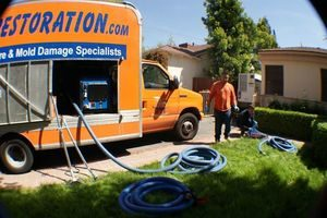 Water Damage Restoration Truck With Equipment In Use